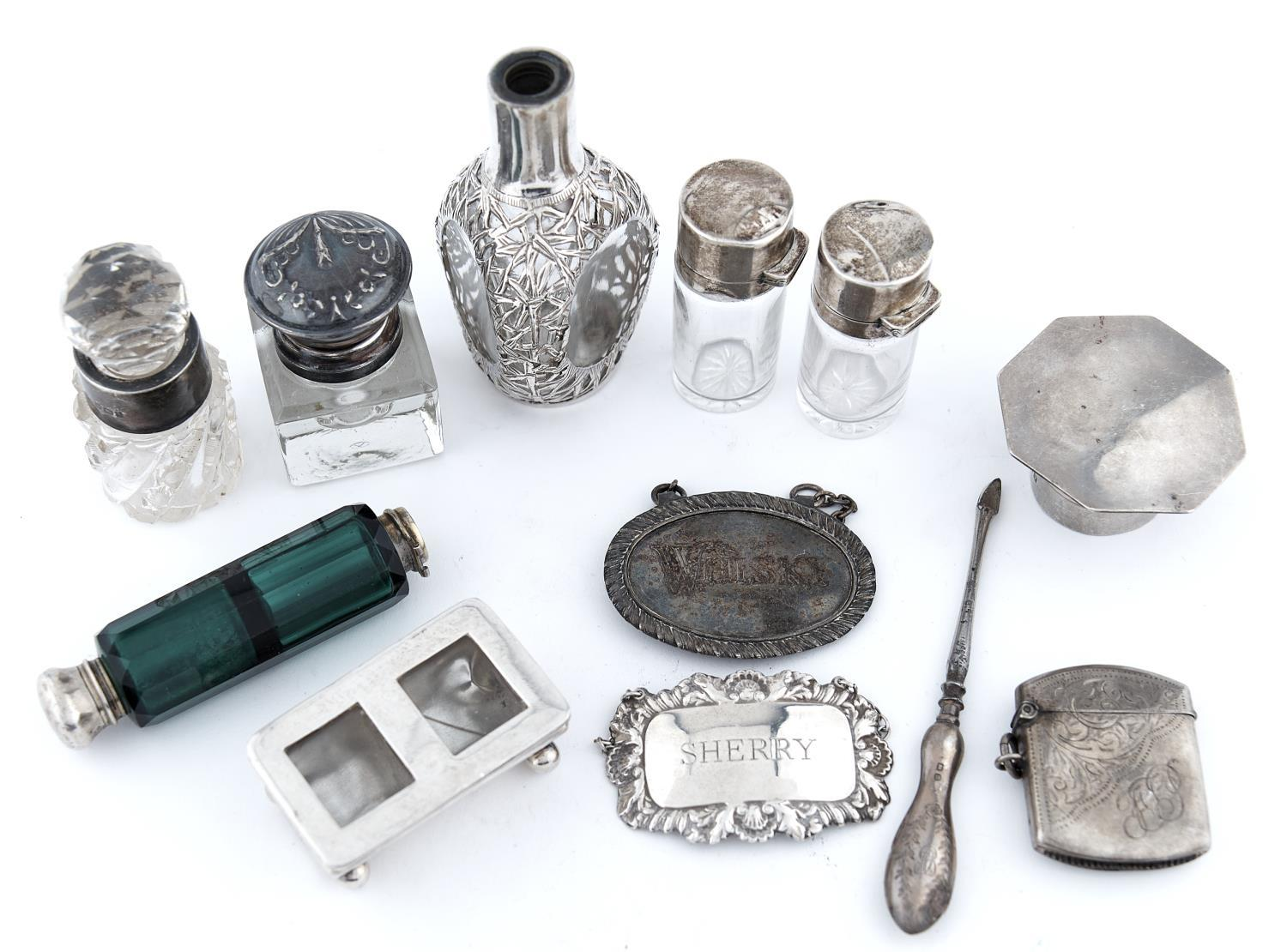 TWO SIMILAR SILVER MOUNTED CYLINDRICAL SCENT BOTTLES, 55 AND 60MM H, MARKS RUBBED, BIRMINGHAM, EARLY
