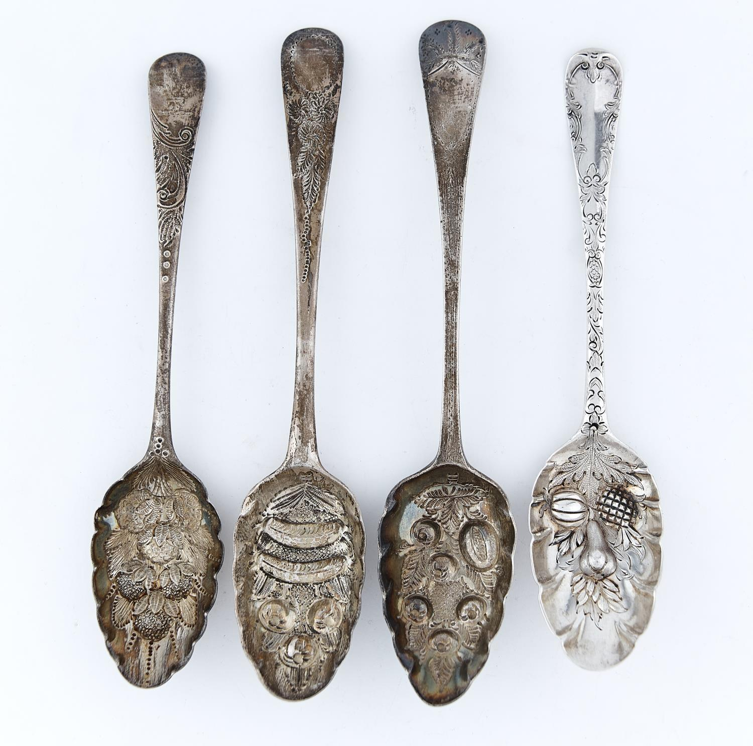 FOUR GEORGE II/III SILVER TABLESPOONS, LATER CHASED AND GILT AS BERRY SPOONS, ALL LONDON, BY VARIOUS