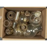 A SMALL COLLECTION OF BRASS OIL LAMPS, INCLUDING HAND LAMPS AND A CANDLESTICK, 19TH C AND LATER, AND