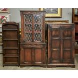 A REPRODUCTION OAK CORNER CUPBOARD IN LATE 17TH C STYLE, C1970'S, CARVED FRIEZE ABOVE A PAIR OF LEAD