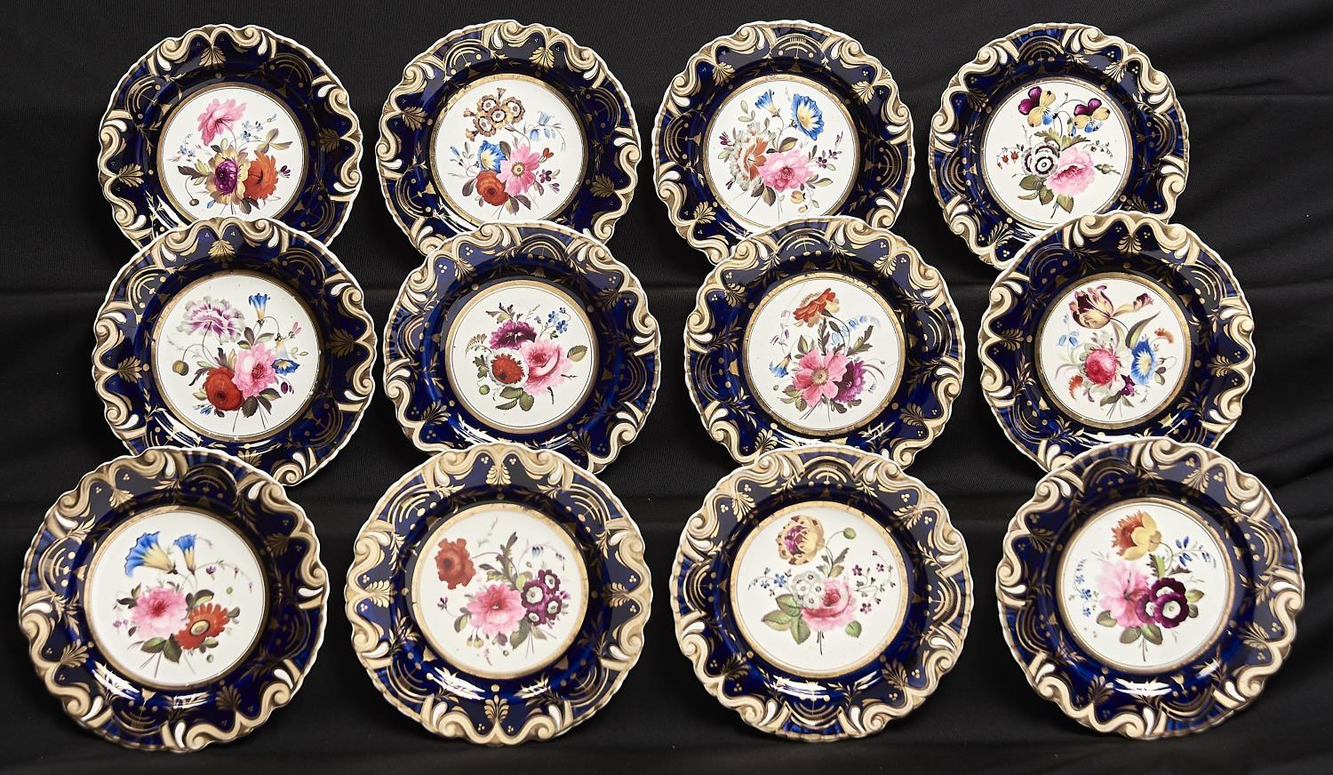 A SET OF TWELVE JOHN AND WILLIAM RIDGWAY DESSERT PLATES, C1825, PAINTED WITH FLOWERS IN MOULDED BLUE