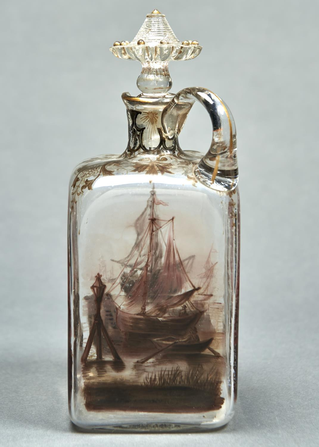 A LOW COUNTRIES ENAMELLED GLASS SPIRIT FLASK AND STOPPER, C1900, OF SQUARE SHAPE, PAINTED IN BROWN