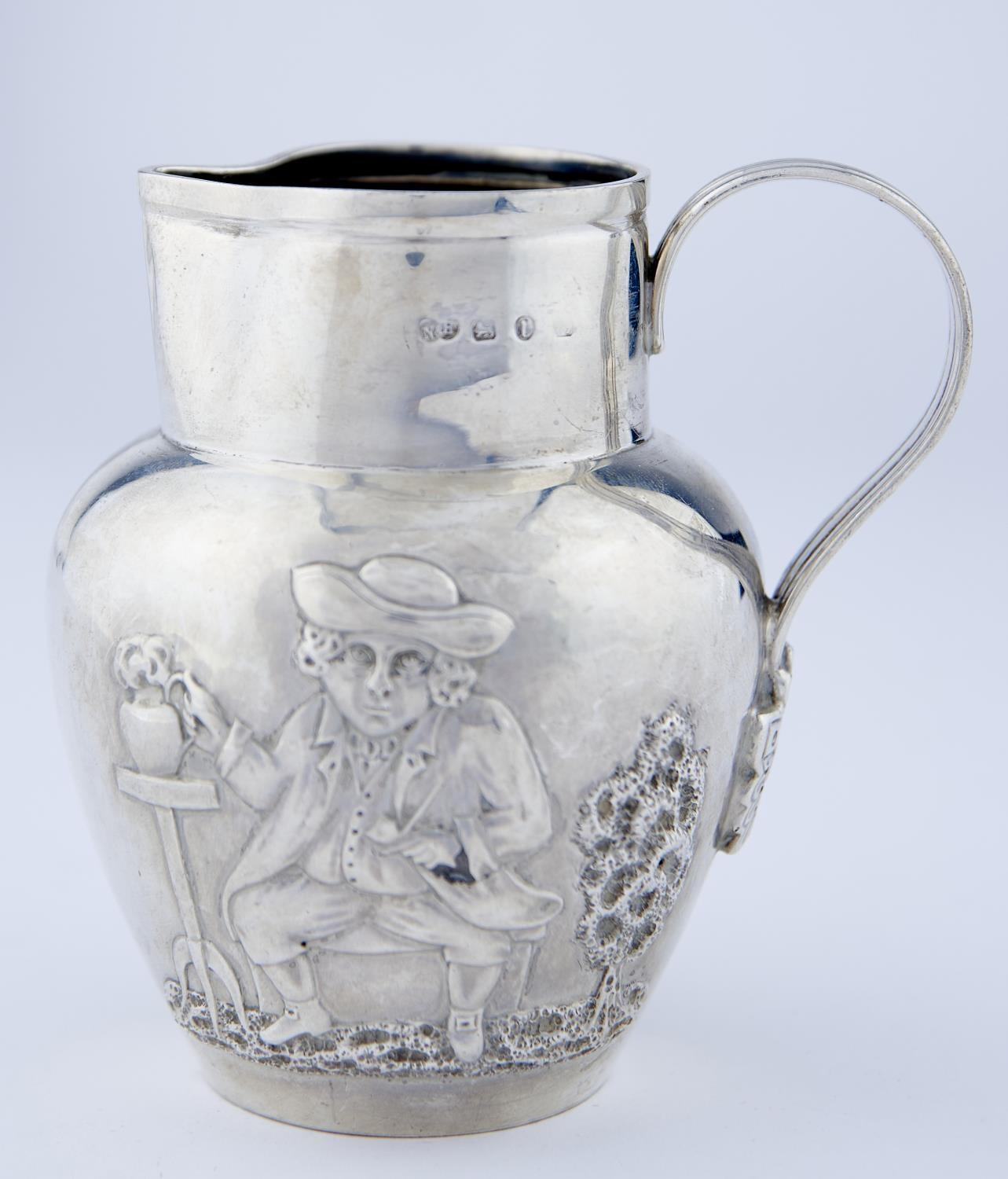 A VICTORIAN SILVER DUTCH JUG, EMBOSSED TO EITHER SIDE WITH TOPERS, THE REEDED HANDLE TERMINATING