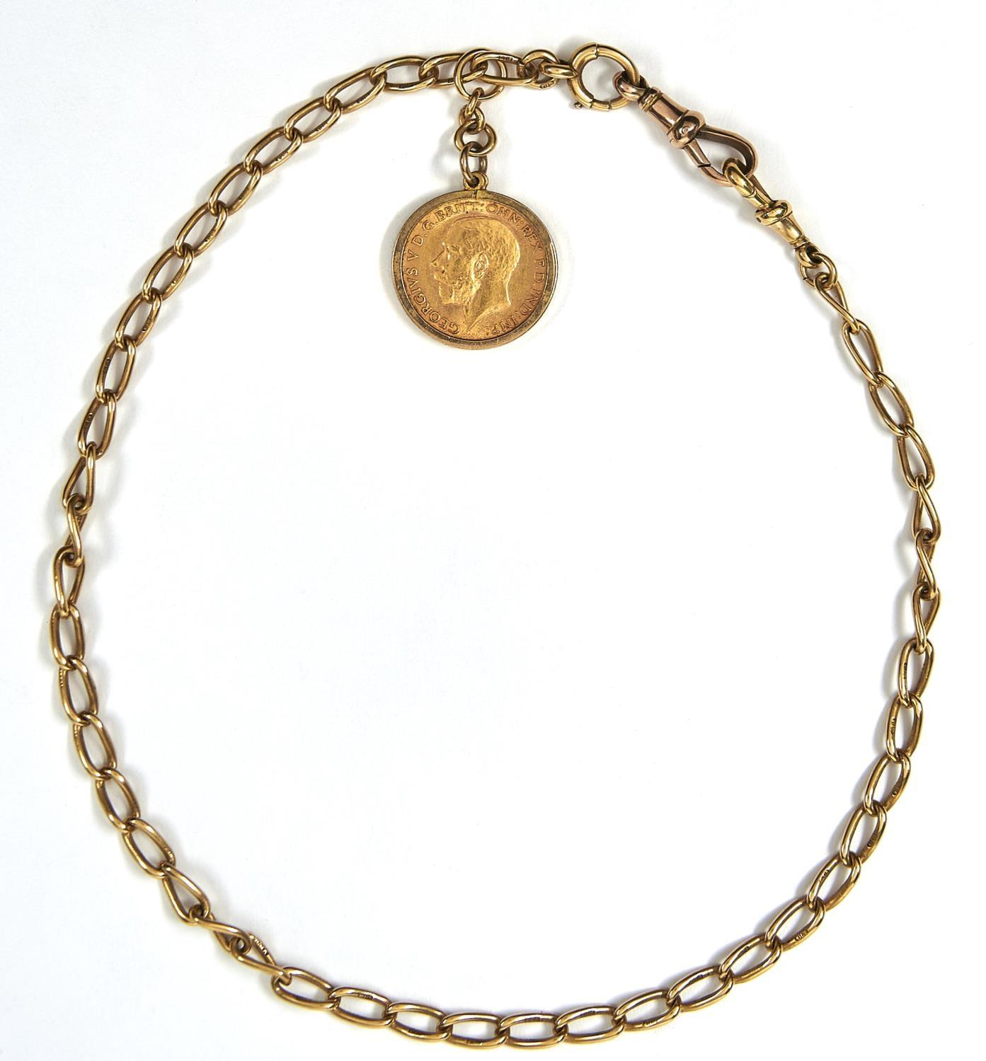 GOLD COIN. HALF SOVEREIGN 1913 MOUNTED IN 9CT GOLD, ON AN 18CT GOLD WATCH CHAIN, EARLY 20TH C,