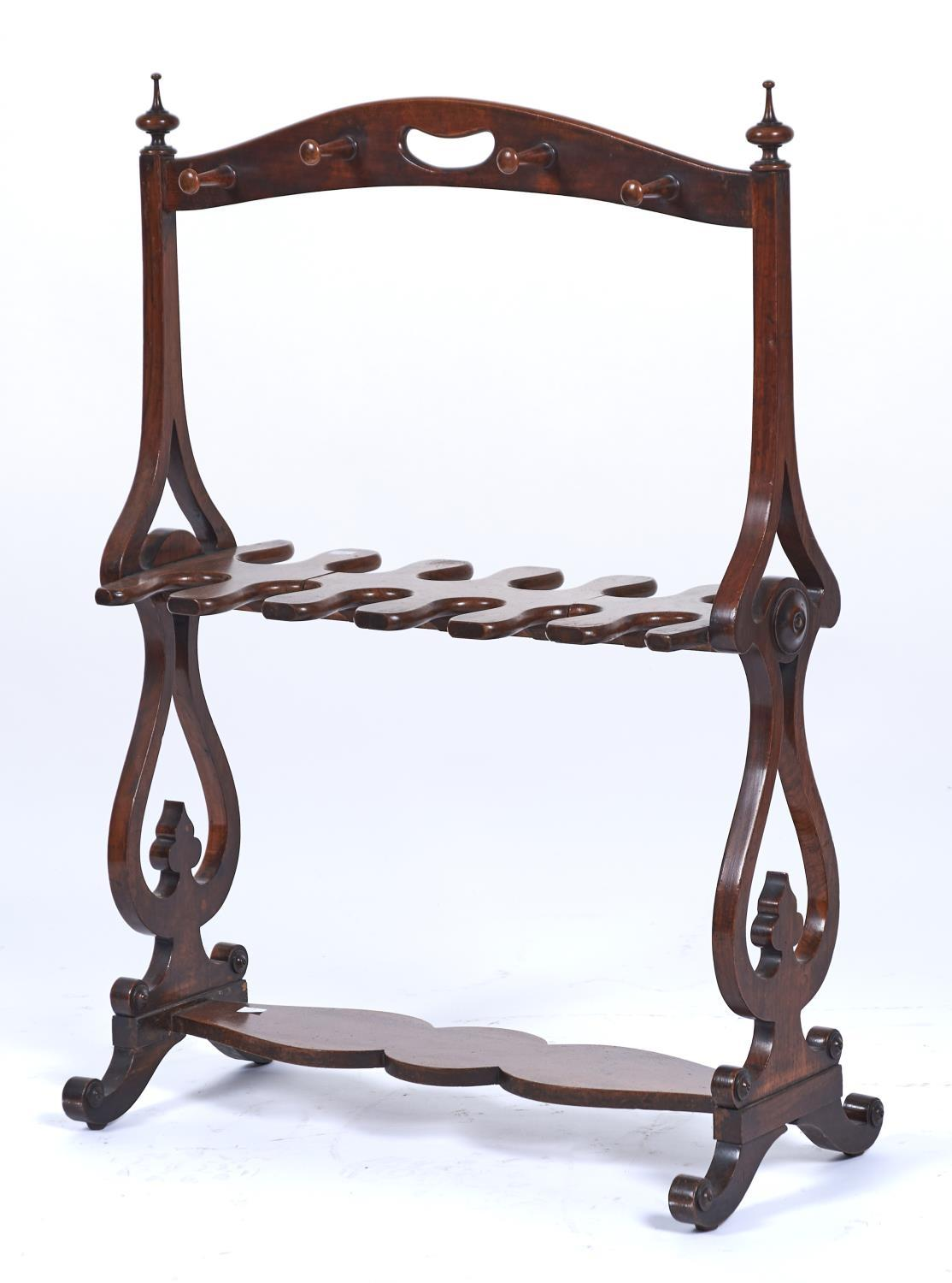 A VICTORIAN WALNUT WHIP AND BOOT RACK, C1840, THE ARCHED TOP RAIL WITH KIDNEY SHAPED CARRYING HANDLE
