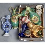 AN EDWARDIAN POTTERY THREE PIECE GARNITURE, COMPRISING LIDDED TWO HANDLED BALUSTER VASE MOULDED WITH