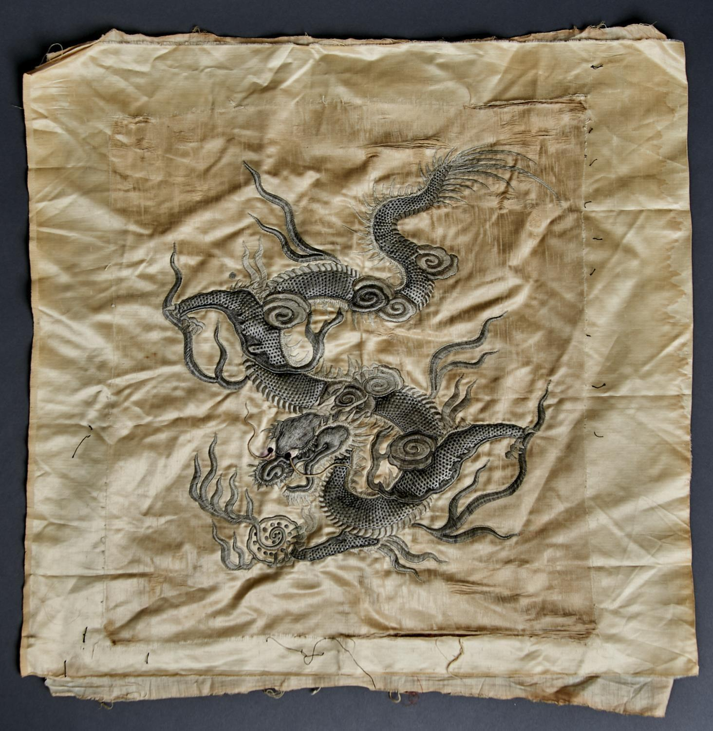 A CHINESE EMBROIDERED IVORY SILK DRAGON PANEL, EARLY 20TH C, 57 X 60CM Slightly stained and