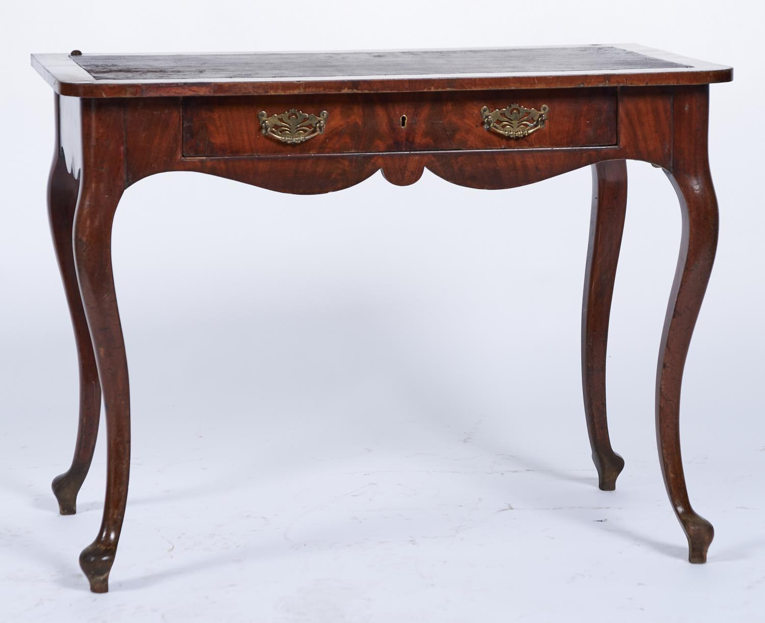 A CONTINENTAL MAHOGANY VENEERED WRITING TABLE, THE RECTANGULAR TOP WITH ROUNDED FRONT CORNERS, INSET
