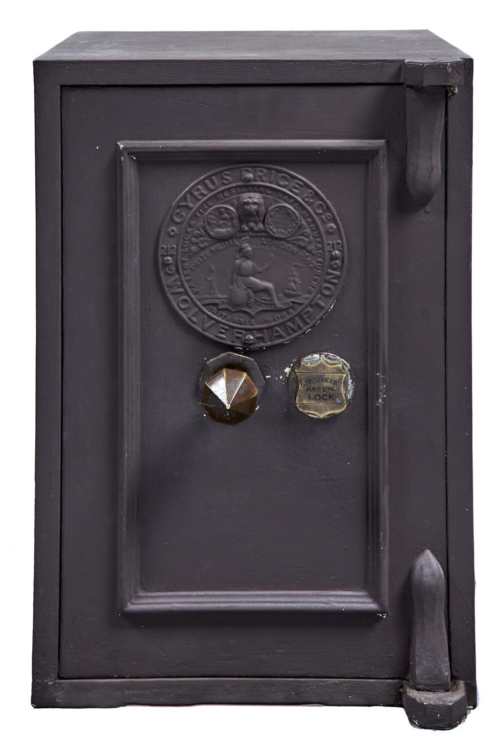 A SMALL SAFE, LATE 19TH C, THE FRONT BEARING CIRCULAR PLATE INSCRIBED CYRUS, PRICE & CO