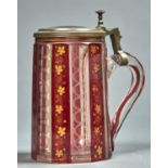 A BOHEMIAN PEWTER MOUNTED, RUBY CASED, ETCHED AND GILT GLASS TANKARD, C1860, GILT IN UPRIGHT