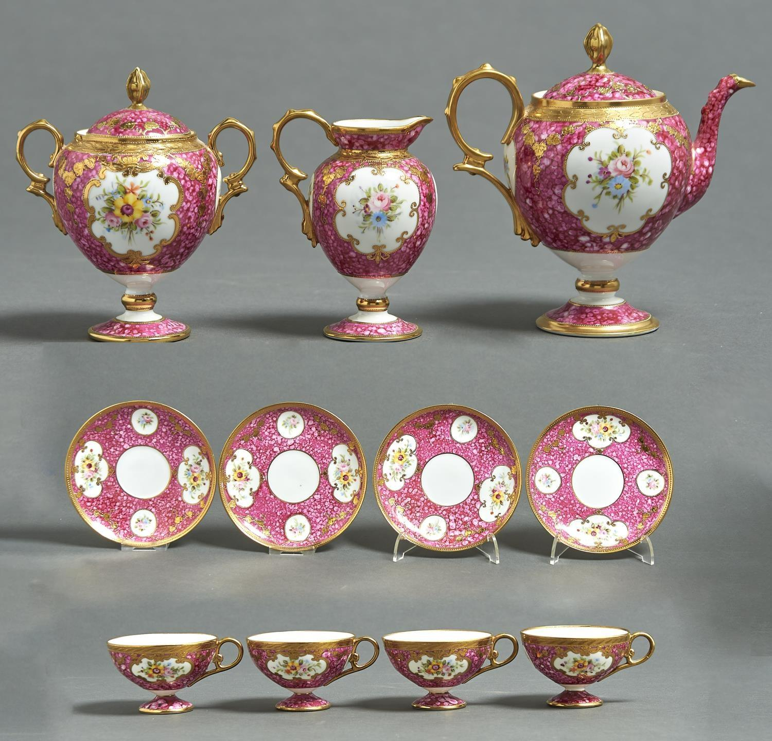 A NORITAKE TEA SERVICE, EARLY 20TH C, OF VASE SHAPE PAINTED WITH FLOWERS IN RAISED GILT RESERVES