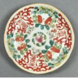 A CHINESE FAMILLE ROSE SAUCER, 19TH C, PAINTED WITH INSECTS AND SHOU CHARACTERS, 13.5CM DIAM Light