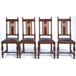 A SET OF FOUR OAK DINING CHAIRS, C1920, THE GEOMETRIC CARVED TOP RAILS WITH BALL FINIALS ABOVE