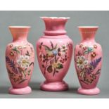 ONE AND A PAIR OF VICTORIAN ENAMELLED PINKOPALINE OVERLAY GLASS VASES, C1870, BOLDLY PAINTED WITH A