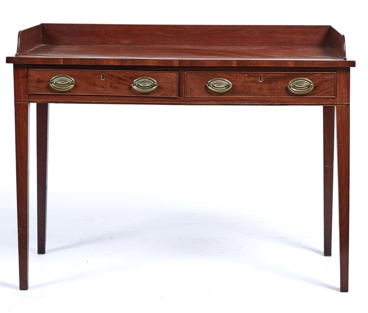 A GEORGE III MAHOGANY WASHSTAND, C1800, WITH THREE QUARTER GALLERY ABOVE TWO COCKBEADED FRIEZE