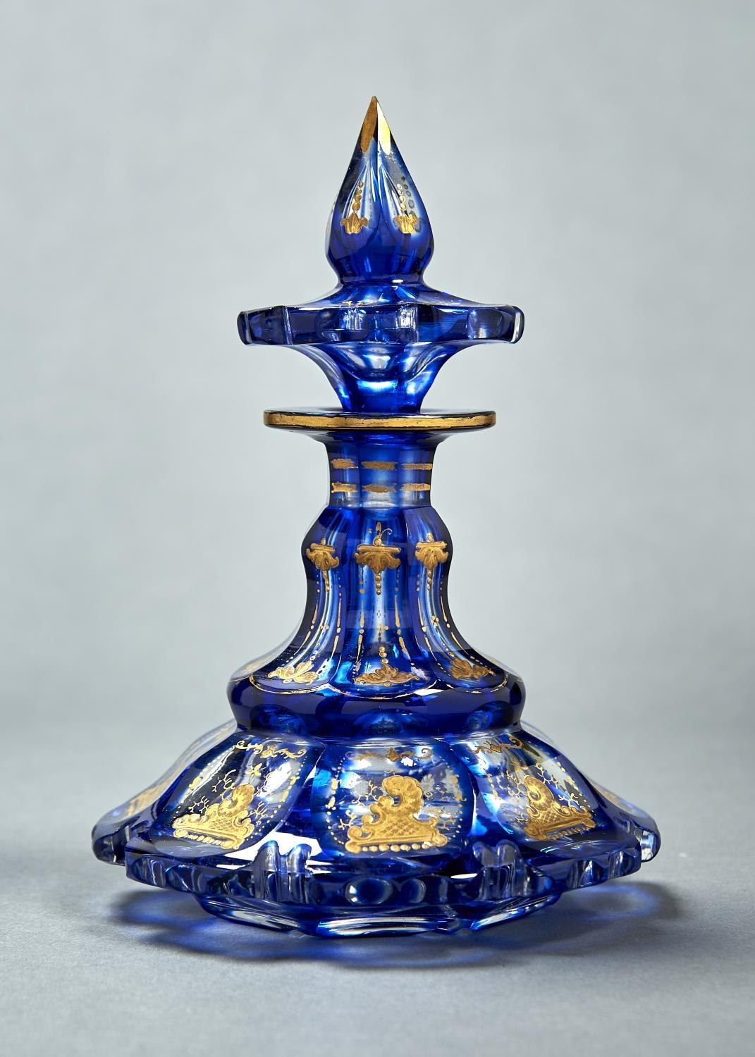 A BOHEMIAN BLUE CASED GLASS SCENT BOTTLE AND STOPPER, C1860, THE FACETS IN RAISED GILDING WITH