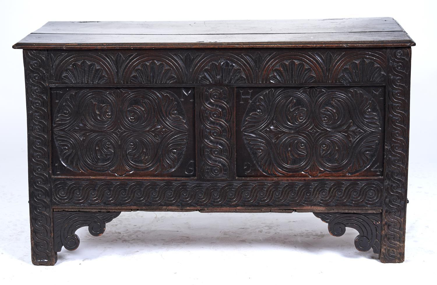 A LATE 17TH C OAK BLANKET CHEST, THE TWIN PLANK TOP WITH MOULDED LIP ABOVE FRIEZE CARVED FOLIATE
