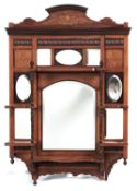An Edwardian rosewood and inlaid wall mirror, the principal arch topped bevelled plate bordered by