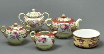 A Noritake two handled sugar bowl and cover, early 20th c, painted with roses in turquoise and