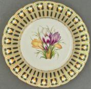 A Minton reticulated Devon shape botanical dessert plate, c1840, painted with crocuses, 23.5cm diam,