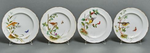 A set of four Minton bone china dessert plates, 1868, painted with different birds and insects on