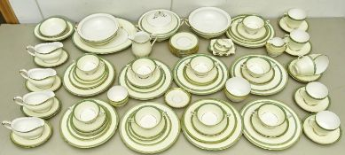 An extensive Shelley porcelain dinner service,with pale cream and apple green borders with gilt