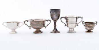 Five miniature silver trophy cups, 5cm h and smaller, various makers and dates, 20th c, 11ozs