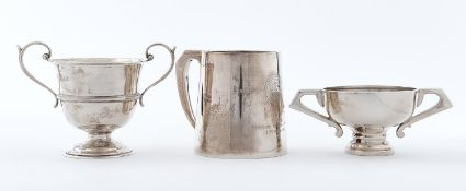 A George VI silver mug, 88mm h, by Crisford & Norris Limited, Birmingham 1939 and two silver