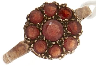 A 9ct gold red stone cluster ring, 2.2g, size O