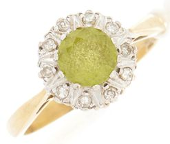 An 18ct gold diamond and peridot ring, 3.9g, size N½