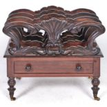 A Victorian carved rosewood canterbury, on turned legs and brass castors, 44cm h; 53 x 37cm Minor