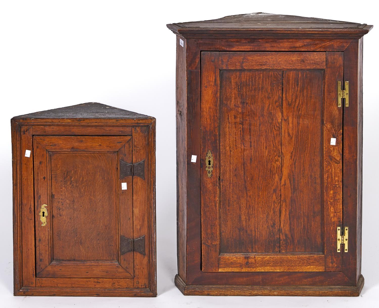 A Victorian oak corner cupboard with panelled door, 91cm h; 72cm w and a contemporary oak corner