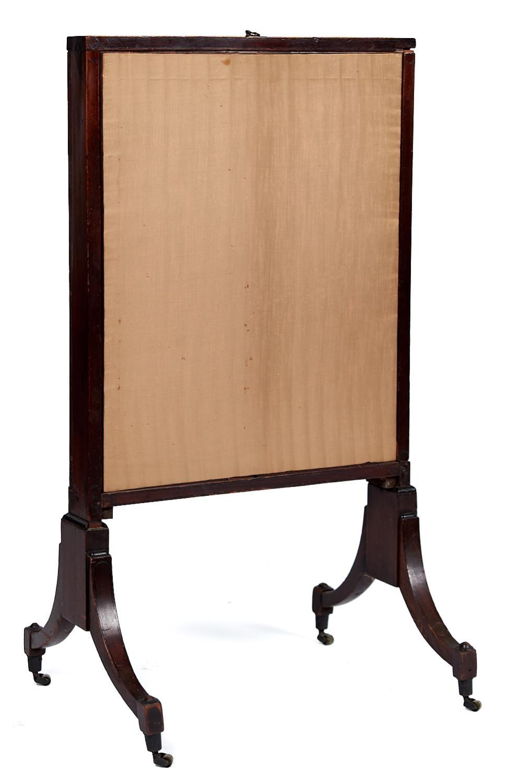 A George III mahogany firescreen, c1800,with ebonised stringing, the rectangular mahogany frame