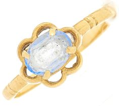 A pale blue paste ring, in gold marked 750, 2.4g, size M