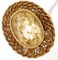 A citrine ring, in gold marked 18k, 7.5g, size J