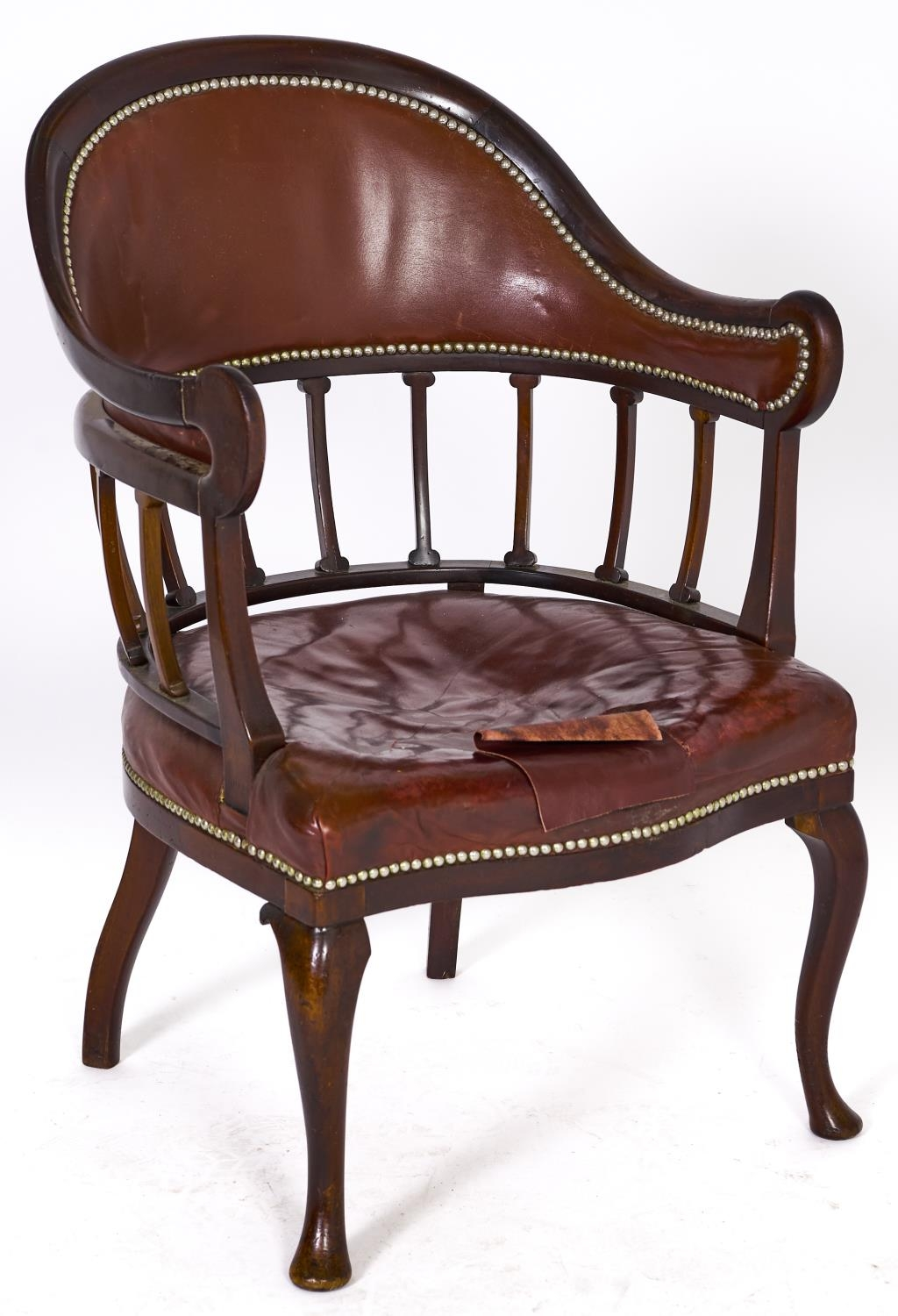 A Victorian mahogany armchair, covered in brown nailed back leather, seat height 42cm Repair to