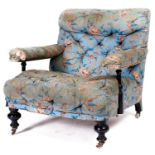 A Victorian ebonised open armchair, late 19th c, in the original light blue ground rose and bird