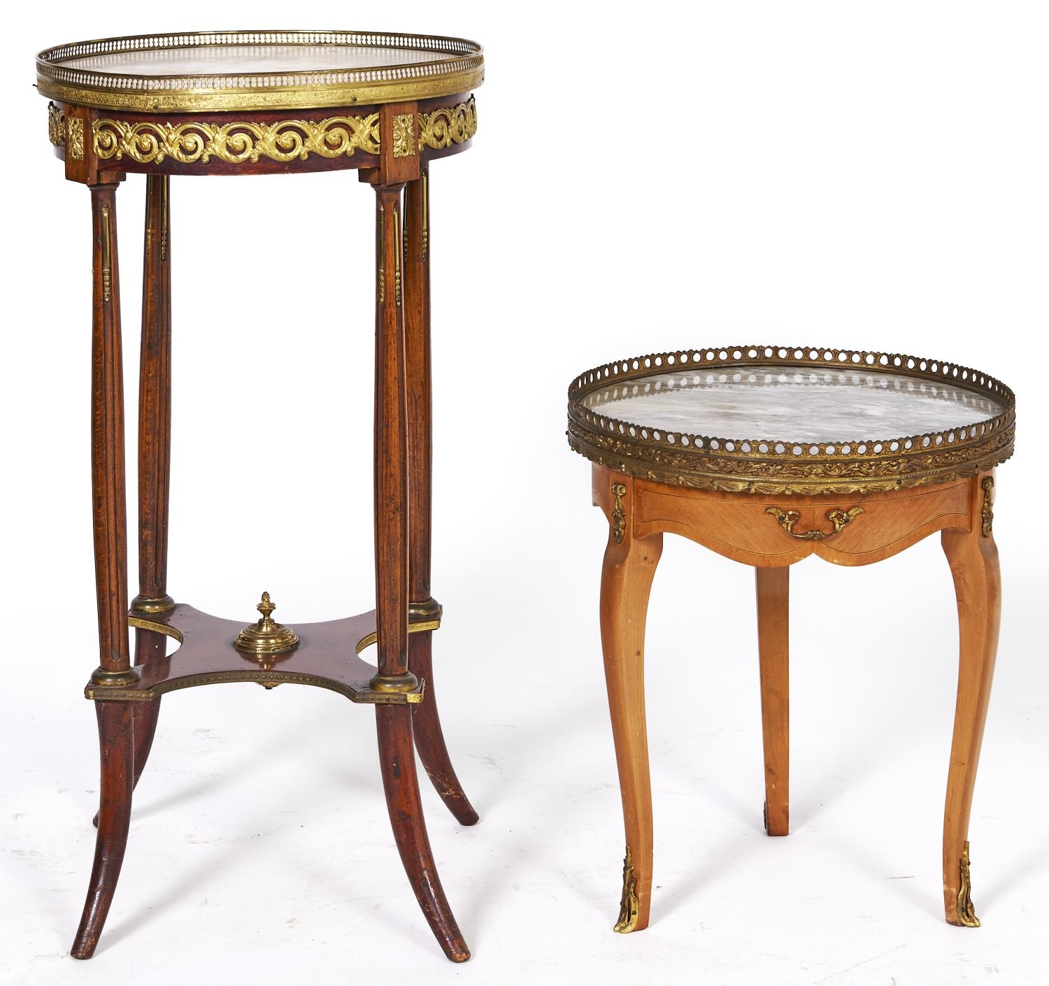 Two French graduated giltmetal mounted mahogany torcheres, late 20th c, with marble top, 48 and 78cm
