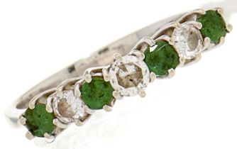A seven stone emerald and diamond ring, diam wt 0.22ct, emerald wt 0.6ct, in white gold marked