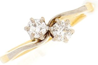 A diamond crossover ring, in gold marked 18ct, 2g, size K½