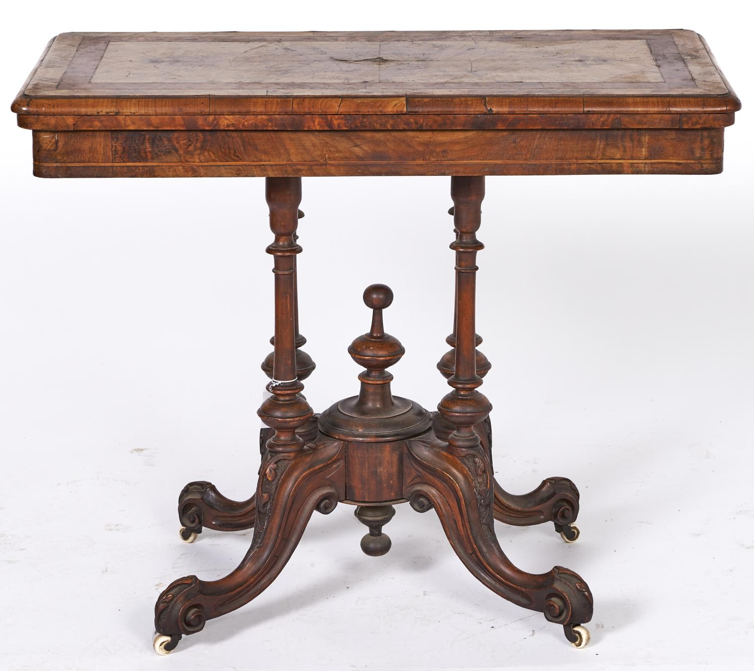 A Victorian inlaid walnut folding card table, with quarter veneered top, turned and carved