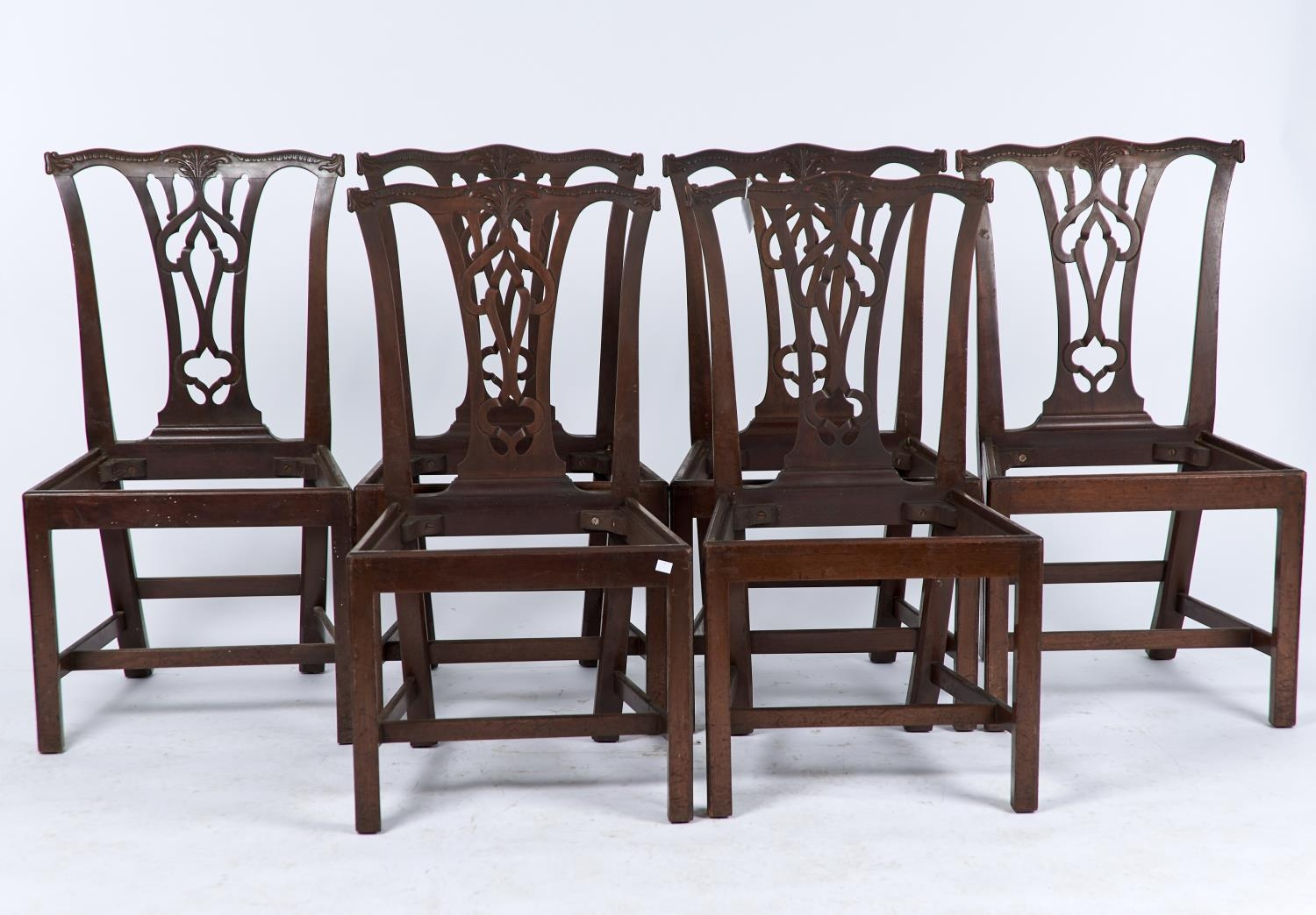 A set of six mahogany dining chairs, c1880, in George II style, foliate carved serpentine cresting