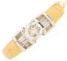 A zircon and diamond ring, in gold marked 18k, J/K and I colour, 4.5g, size Q½