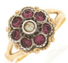 A paste cluster ring, in gold marked 750, 3.6g, size L