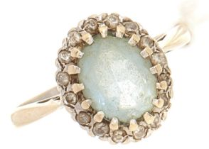 An 18ct white gold diamond and aquamarine ring, 4.7g, size P
