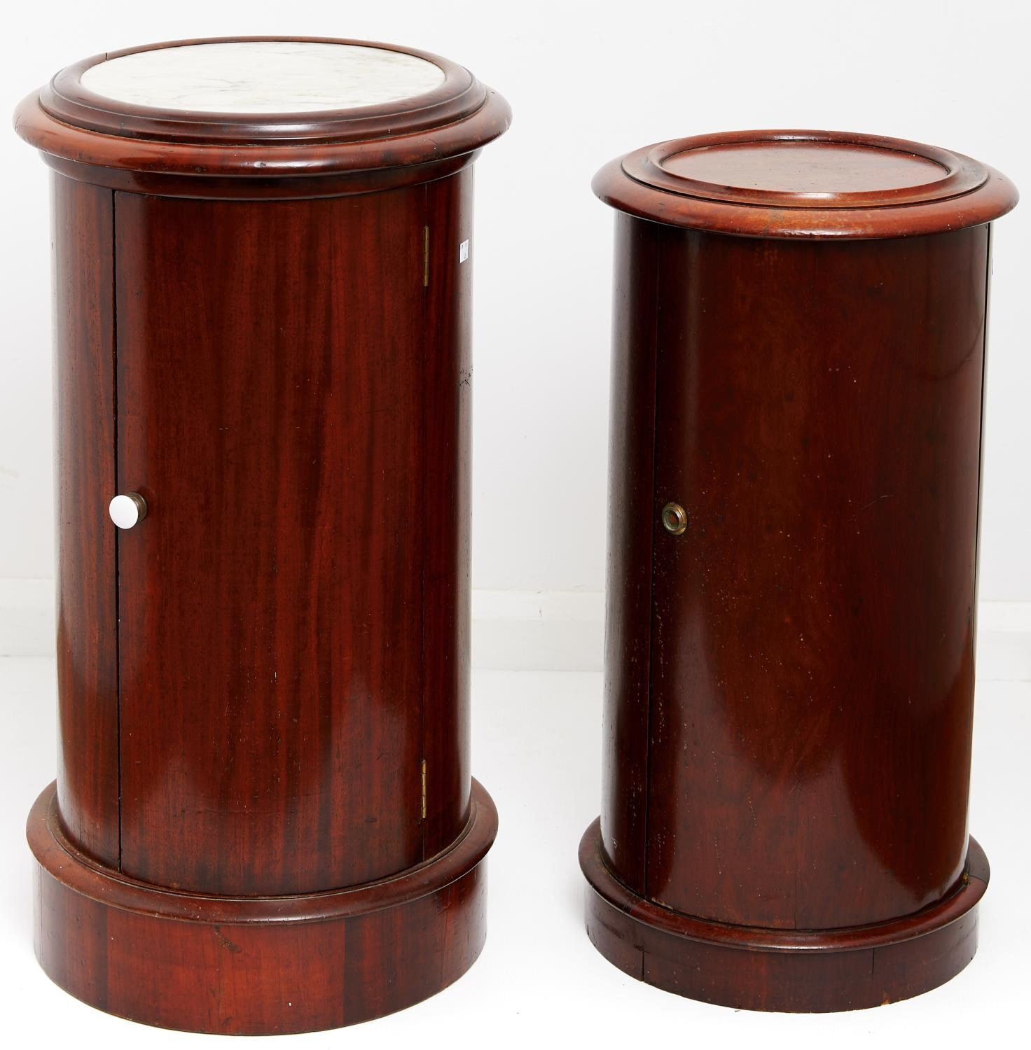 Two Victorian mahogany cylindrical pot cupboards, late 19th c, with panelled or marble inset top, on