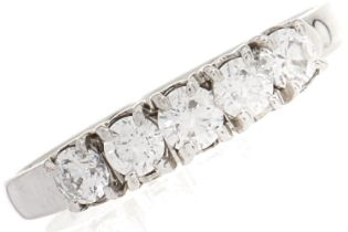 A cubic zirconia ring, in white gold marked 18kt, 3.3g, size O