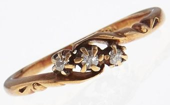 A three stone diamond ring, in 18ct gold, 1.9g, size L Wear consistent with age