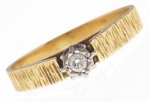 A diamond solitaire ring, in bark textured gold marked 18ct, 3.4g, size Q½ Good condition