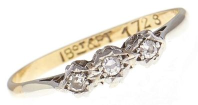 A three stone diamond ring, in gold marked 18ct & PT, 1.8g, size M Hoop distorted